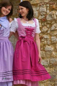 Girly fabulous pink and purple dirndls with lace up bodices.