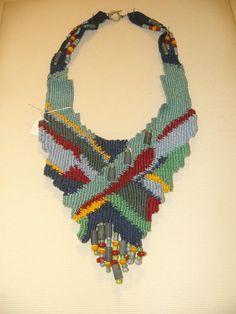 Anastasia Iordanaki-short necklace: cotton, glass beads and blue mineral stones