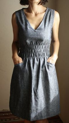 """the simplicity, the fabric, the heathered grey, the ruching at the waist, the pockets (very important) / that it looks like the feminine curves version of those """"painter at his studio"""" clothes"""