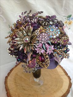 Beautiful purple brooch bouquet created by Muscari whites florist… Purple Brooch Bouquet, Bling Bouquet, Wedding Brooch Bouquets, Diy Bouquet, Bride Bouquets, Flower Bouquet Wedding, Non Flower Bouquets, Bridal Flowers, Art Deco Wedding