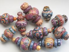 Alladdin beads - polymer  My hubby said these reminded him of Alladdins lamp - so thats what Im calling them.  They all get a thin coating of liquid polymer and then shined up even more on the wheel.  The big ones are about the size of a regular spool of thread. By dixie103
