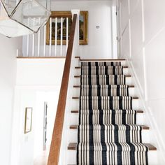 Dash & Albert stair runner, Birmingham Black, Now I want to use a striped runner on my stairs Our farm house has an old stairway. This runner almost looks like ticking with its navy and white stripes. Painted Stairs, Wood Stairs, Basement Stairs, Entryway Stairs, Foyers, Birmingham, Staircase Runner, Staircase Ideas, Stairs