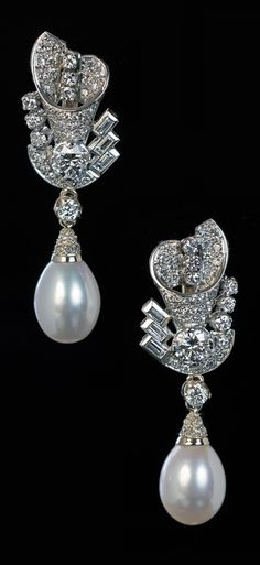 A pair of late Art Deco gold, diamond and pearl earrings, circa 1940.