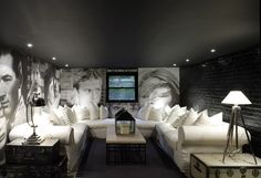Fun media room design with black ceiling, exposed brick wall painted a glossy bl. Fun media room design with black ceiling, exposed brick wall painted a glossy black, white slip-cov Home Theater Rooms, Home Theater Design, Cinema Room, Basement Movie Room, Dark Basement, Low Ceiling Basement, Cozy Basement, Basement Lighting, Modern Basement