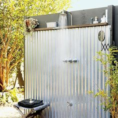 Love this outdoor shower.  Would be so great w/Evyian!