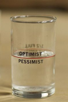"""Glass Printed with 'Half Full/Half Empty' on one side and 'Optimist/Pessimist' on the other side.Size: 2.5"""" D x 4.25"""" H"""