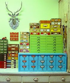 Card catalog painted blue, amidst all kinds of cool storage, including cigar boxes. Very neat pics of someone's craft space at the source. Everything is very colorful like this pic.