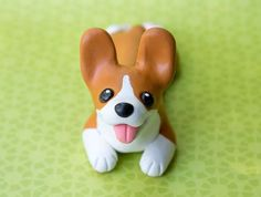 I really like those big ears made out of polymer clay and painted with acrylics ------------------ Would ... Corgi pup sculpture