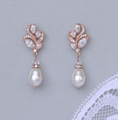 Rose Gold Bridal earrings made with Swarovski crystals are set in a graceful leaf shaped design for a classic and delicate earring. A