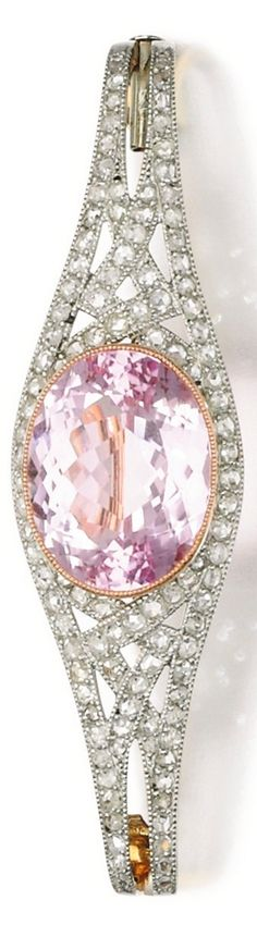 An Art Deco kunzite and diamond brooch, early 20th century composite. Set to the centre with an oval kunzite, the mount millegrain-set with rose diamonds.