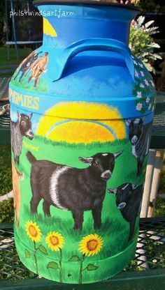 Painted Milk Cans Painted Milk Cans, Goat Playground, Goat Paintings, Old Milk Cans, Goat Art, Cute Goats, Cow Painting, Baby Goats, Barn Quilts