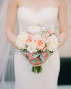 The bride at this Chicago wedding held a clutch of garden roses, spray roses, dahlias, seeded eucalyptus, ranunculus, and tweedia, from Life in Bloom.