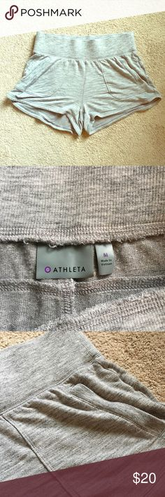 Athleta Short Shorts - EUC These shorts will keep you covered while working out or running errands. Item has an elastic waistband and two side pockets. Comes from a smoke-free and pet-free home. Athleta Shorts