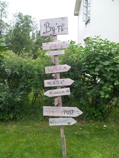 """""""Directions"""" post in center of town, Fyresdal, Norway"""