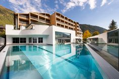 Stay at Falkensteinerhof Hotel & Spa in South Tyrol, Italy. Book your accommodation with us at the best rate and enjoy excursions, ski, hiking ans wintersports. Spa Hotel, South Tyrol, Outdoor Pool, Skiing, Italy, In This Moment, Mansions, House Styles, Vacation