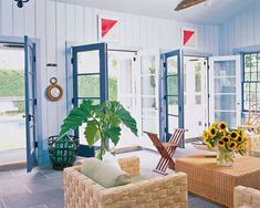 """Public-relations executive Scott Currie's aim for his Southampton, New York, retreat was to create """"the kind of home a ship's captain would have lived in after years spent exploring the world."""" In the poolhouse, the paneled walls and door frames are painted in Benjamin Moore's Harbor Haze and Spellbound, respectively; a rope clock and vintage signal flags complete the nautical look. Themed Rooms, Nautical Theme Decor, Room Themes, Elle Decor, Make It Yourself, Style, Design, Swag, Outfits"""