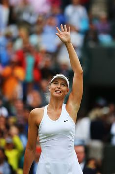 Maria Sharapova Photos: Wimbledon: Day 4. Maria Sharapova of Russia celebrates after winning her Ladies' Singles second round match against Timea Bacsinszky of Switzerland on day four of the Wimbledon Lawn Tennis Championships at the All England Lawn Tennis and Croquet Club at Wimbledon on June 26, 2014 in London, England.