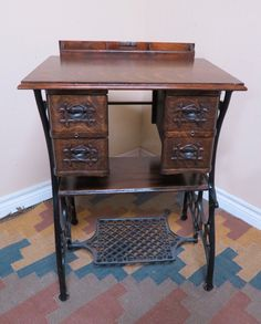 Love this one. The front drawer of the original table is in the back for keys, pens etc.