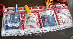 This woman posted a picture of her awesome sewing apron on her blog, and I love it!