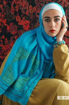 Damask rose embroidery - Ramallah area Blue and green colored stitches, saru fashion palestinian embroidery