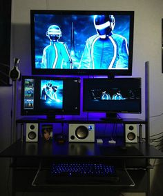 Mega monitor stacked up on a compact desk with purple neon lighting accents. #megadesk #battlestation #workstation