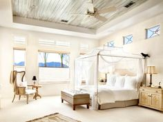 Love birds will find a heavenly escape in this spacious bedroom adorned with romantic design and a luxurious canopy bed.