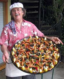 Jim Kuhn, The Paella King, preparing to serve a Paella Mixta...would be fun for a party!