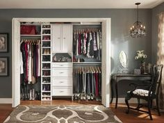 Modern reach-in closet featuring folding white doors