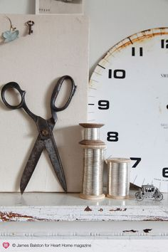 Scissors, wire yarn rolls and clock face ~ fab vignette! Vintage Scissors, Sewing Scissors, Sewing Tools, Sewing Notions, Love Sewing, Hand Sewing, Contemporary Vases, Antique Sewing Machines, House And Home Magazine