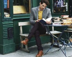 Yellow sweater. Grey sports-coat. Brown boots.