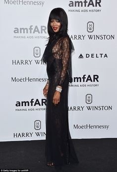 Exquisite: Naomi Campbell flashed sideboob as she arrived Milan's seventh annual amfAR gala on Saturday night