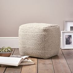 Timelessly stylish, this natural and cream-coloured pouffe features a textured-herringbone weave. Made from cosy wool with a touch of high-quality viscose and filled with comfortable polystyrene beads, it feels soft and comfortable plus, boasts natural temperature-regulating properties and a luxurious-looking lustre. With a contemporary country-cottage style, place it in the living room and enjoy as an additional seat, or foot rest. 45% wool, 25% viscose, 20% cotton, 10% polyester Filling…