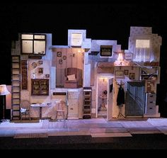 Theatr Genedlaethol Cymru - Sgint Director: Arwel Gruffydd - Designer: Cai Dyfan - Lighting Designer: Elanor Higgins Do with rendered walls. I like the 'make do' wall and lighting coming through Set Theatre, Set Design Theatre, Theatre Stage, Bühnen Design, Prop Design, Design Model, Stage Lighting Design, Stage Set Design, Conception Scénique