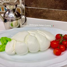 Buffalo mozzarella from Agro Pontino, Italy 🇮🇹 Anyone who has tasted Italian Buffalo mozzarella has fallen in love with it! The fresh milk squishes out, so tender under the fork cut, and the flavor is an explosion of happiness in your mouth... this is how much I miss it! #visititaly #italy #terracina #sezze #bellangela #rome #travels #italytour #vacation #romeitaly #italiantreasures #freshfood #italianart #cheeselover #buffalomozzarella #buffalo #freshmozzarella #italyfoodietour…