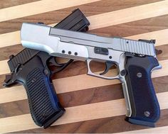 """tacticalsquad: """"  Repost from @sig_dude - #SigSaturday Second Edition … These are two of my favorite things… @sigsauerinc#P220 Sport and P220 Carry Elite SAO @hogueinc G10 grips are a must. """""""