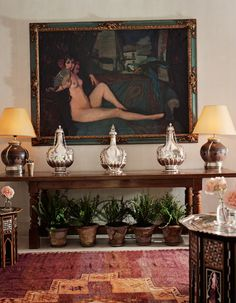 Marella Agnelli's house, Ain Kassimou, in Marrakech.  Reclining Maja with Blue and Gold Parrot by Ignacio Zuloaga y Zabaleta hangs over a table in the living room.  Design by Alberto Pinto.  Photo by Oberto Gili.