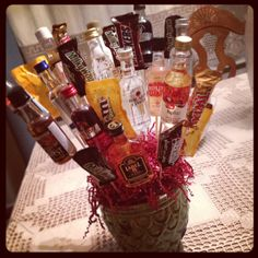 Man bouquet! Love this is idea minus the liquor and put some tees ...