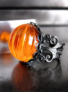 Neon Orange Pumpkin Ring, Halloween Jewelry, Day Glo Bright I need this for Halloween! Orange Cocktail Ring, Black Gunmetal Adjustable Ring, Dark Goth Gothic Ring via Etsy.