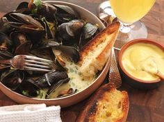 A pot of classic French Moules Marinières is fast food at its best. Made with fresh, inexpensive ingredients that still seem celebratory, this dish comes together in around 15 minutes from start to finish. Make sure to serve it with the rest of the wine left in the bottle and with plenty of toasted bread for dipping into the garlicky, briny broth.