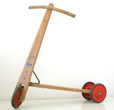Vintage wooden mid century scooter.