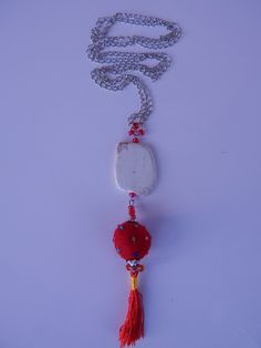 Long silver nacklace made of a white #stone bead, red #felt ball and matching thread #tassels. Very uniq and brave combination. www.ayaglass.hu