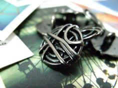 Hey, I found this really awesome Etsy listing at https://www.etsy.com/listing/66827538/metal-buttons-bunch-of-rope-metal