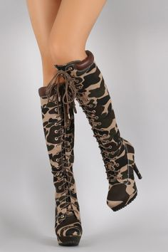"Bamboo Camouflage Combat Lace Up Stiletto Platform Boots. Description These trendy  knee high boots  feature an almond toe silhouette, camouflage print canvas upper, metal grommets with lace up front design, top stitching accents, tribute platform, and wrapped stiletto heel. Finished with cushioned insole, soft faux fur interior lining, and side zipper closure for easy on/off.Material: Canvas (man-made)Sole: Treaded  Measurement Heel Height: 4.75"" (approx)Shaft Length: 20"" (including…"