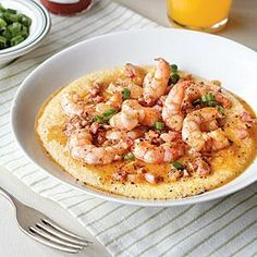 At Castaways Raw Bar and Grill on Holden Beach in North Carolina, they serve up huge portions of spicy shrimp and grits. This version is inspired by theirs—zesty with green onions and tasso ham, with a generous dose of Cajun spice.