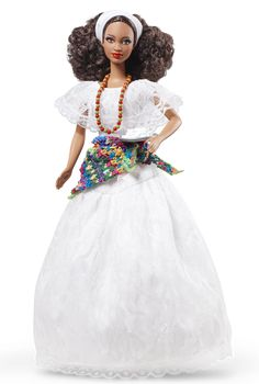 """Olá, collectors! Brazil Barbie doll joins the party in a beautiful white lace festival dress, accented with a vibrant multi-colored wrap. With bead necklaces and strappy-yet-sensible heels, she's ready to celebrate! Includes """"passport,"""" country stickers, a plate of """"cocadas"""", and brush."""