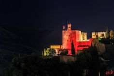 "La Alhambra tinged in pink To show solidarity with the fight against breast cancer, the Alhambra Palace in Granada ""painted"" the Torre de la Vela pink. Photo by Artur Ávila, shared by Dreaming Granada"