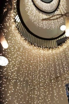 Spiral staircase with twinkling waterfall lights. Christmas Staircase Decor, Decoration Christmas, Light Decorations, Holiday Decor, All Things Christmas, Christmas Home, Christmas Lights, Christmas Interiors, Outdoor Christmas