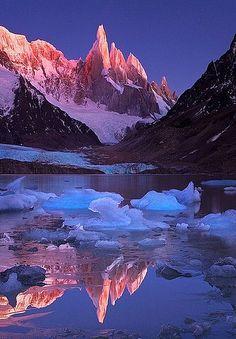 Crimson Crags, Cerro Torre reflected on Laguna Torre, Parque Nacional los Glaciares, Patagonia, Argentina.