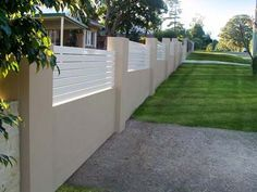 Timber slat and renered wall fence
