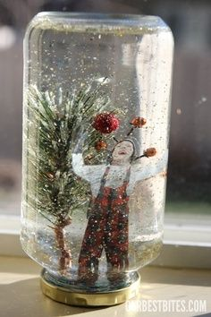 glass jar centerpiece pinecone projects   Homemade snow globe diy-projects